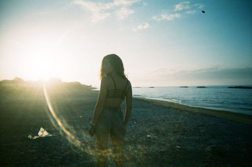 Laura - collab with fausto serafini Disposablecamera People Of The Oceans Analogue Beautiful Woman Analog Filmphotography Sunset Sunset_collection Backlight Film Is Not Dead EyeEm Team Girl Power Beautiful Girl Real People Sea And Sky Sea Seaside An Eye For Travel Go Higher Inner Power