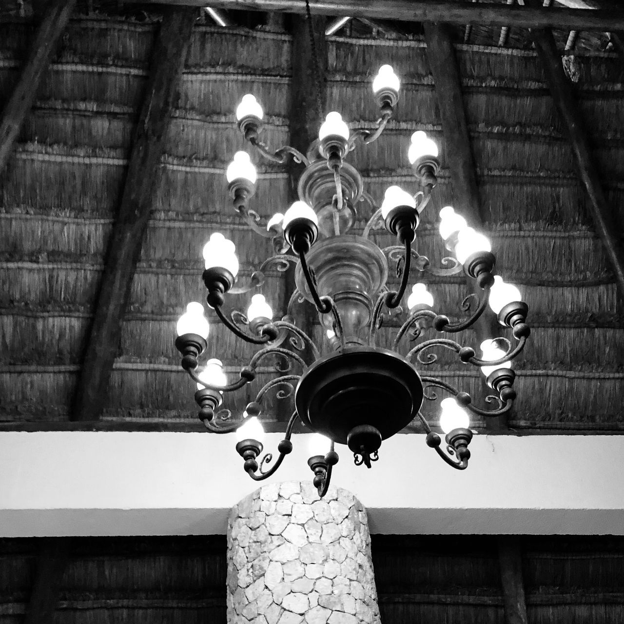 lighting equipment, illuminated, low angle view, hanging, ceiling, no people, indoors, decoration, built structure, architecture, electric lamp, glowing, light, chandelier, electricity, art and craft, electric light, pattern, pendant light, wall - building feature, ornate, light fixture