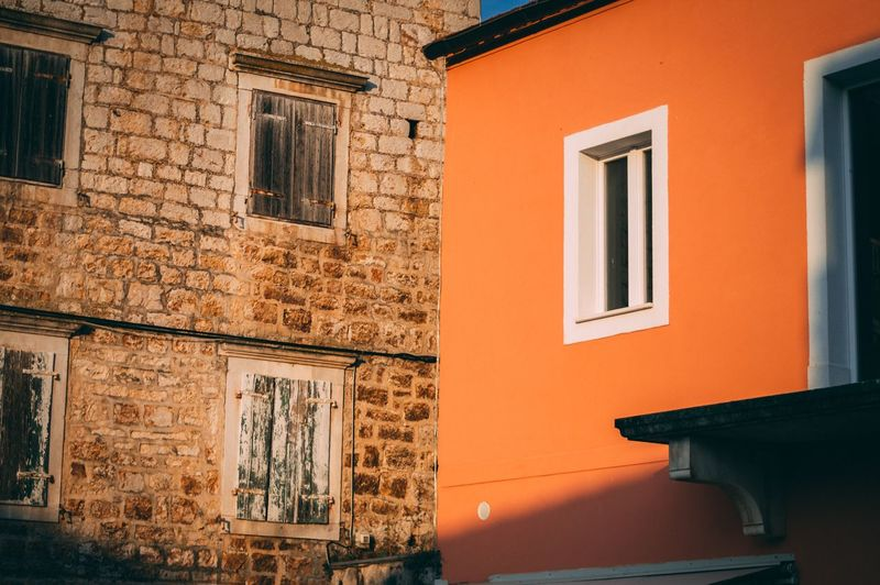 Contrast'sschh Architecture Built Structure Building Exterior Window Building No People Residential District Orange Color Wall - Building Feature Day House Sunlight Wall Old
