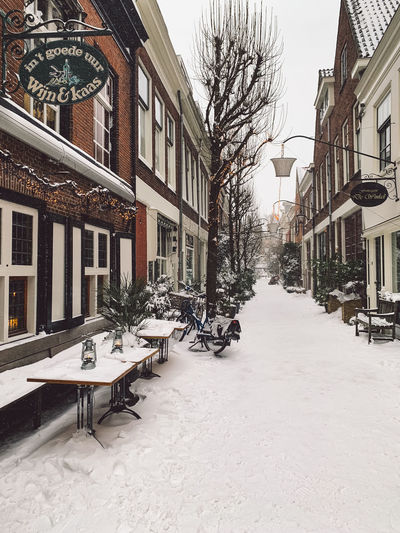 Street amidst buildings in city during winter