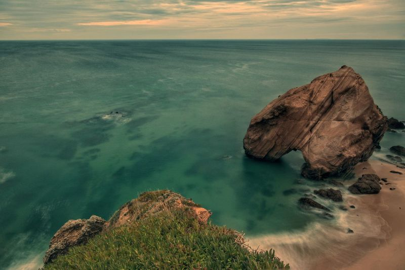 Sea Rock - Object Outdoors Geology Beauty In Nature Scenics Landscape Sunset No People Water Nautical Vessel Nature Sky Day Sunset_collection Popular Nature Beach Beachphotography Popular Photos Tranquil Scene Tranquility Beauty In Nature Cloud - Sky Beachlovers
