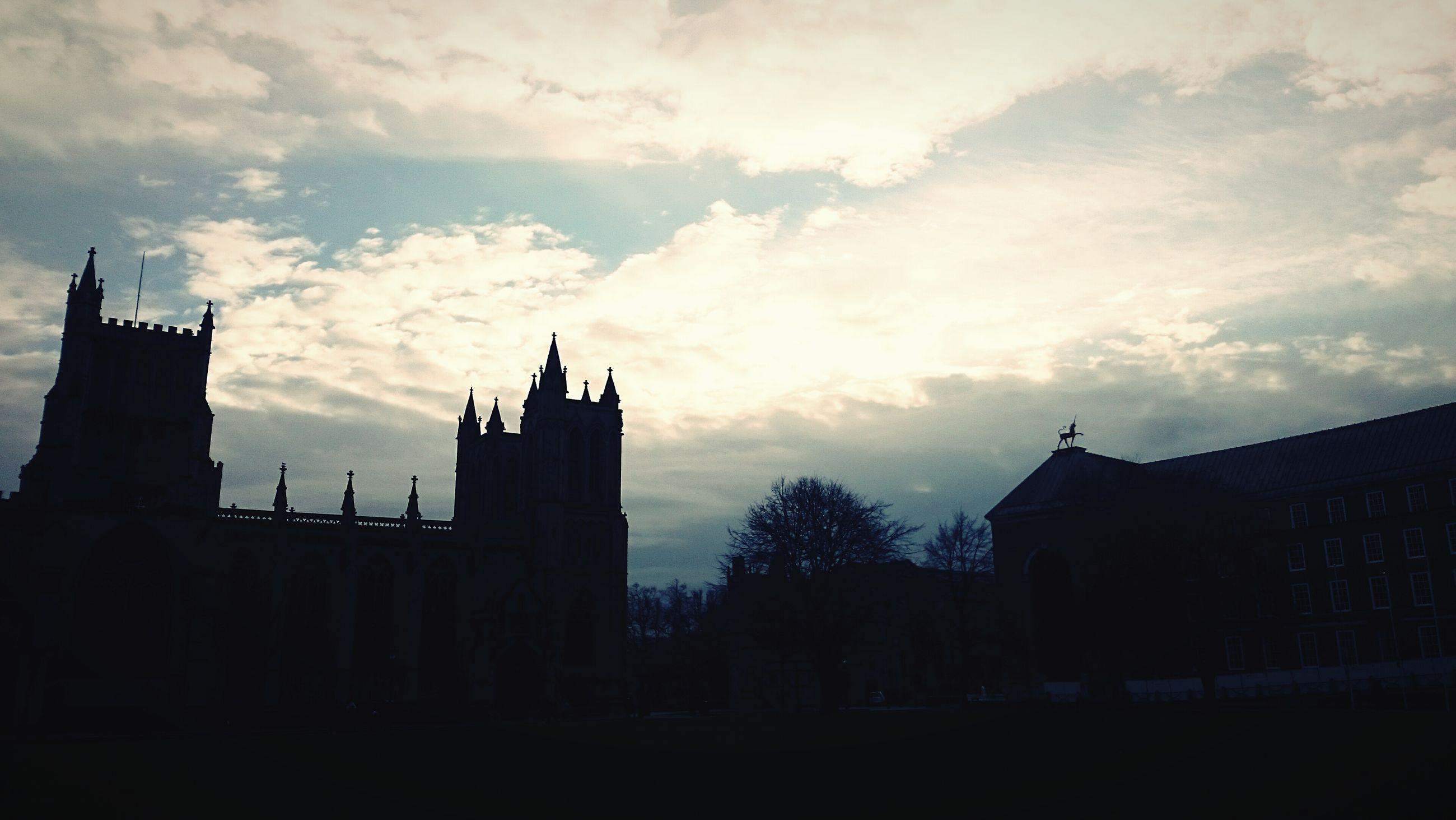 building exterior, architecture, silhouette, built structure, sky, sunset, cloud - sky, low angle view, cloud, building, dusk, city, cloudy, house, residential structure, residential building, outdoors, dark, outline, no people