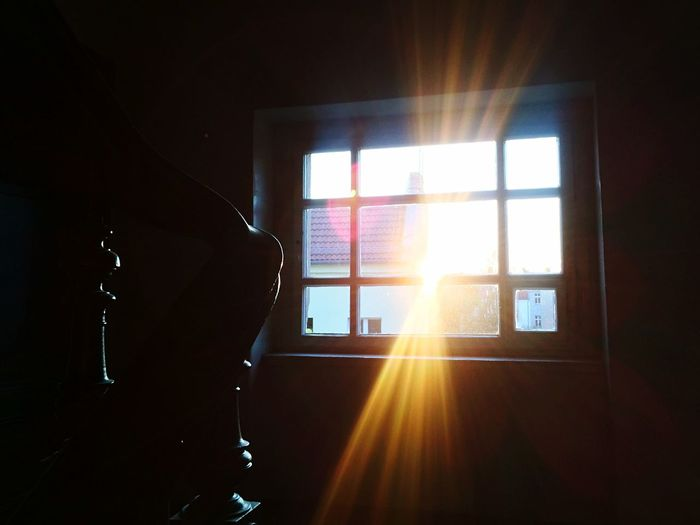 Sunlight streaming through window at sunset