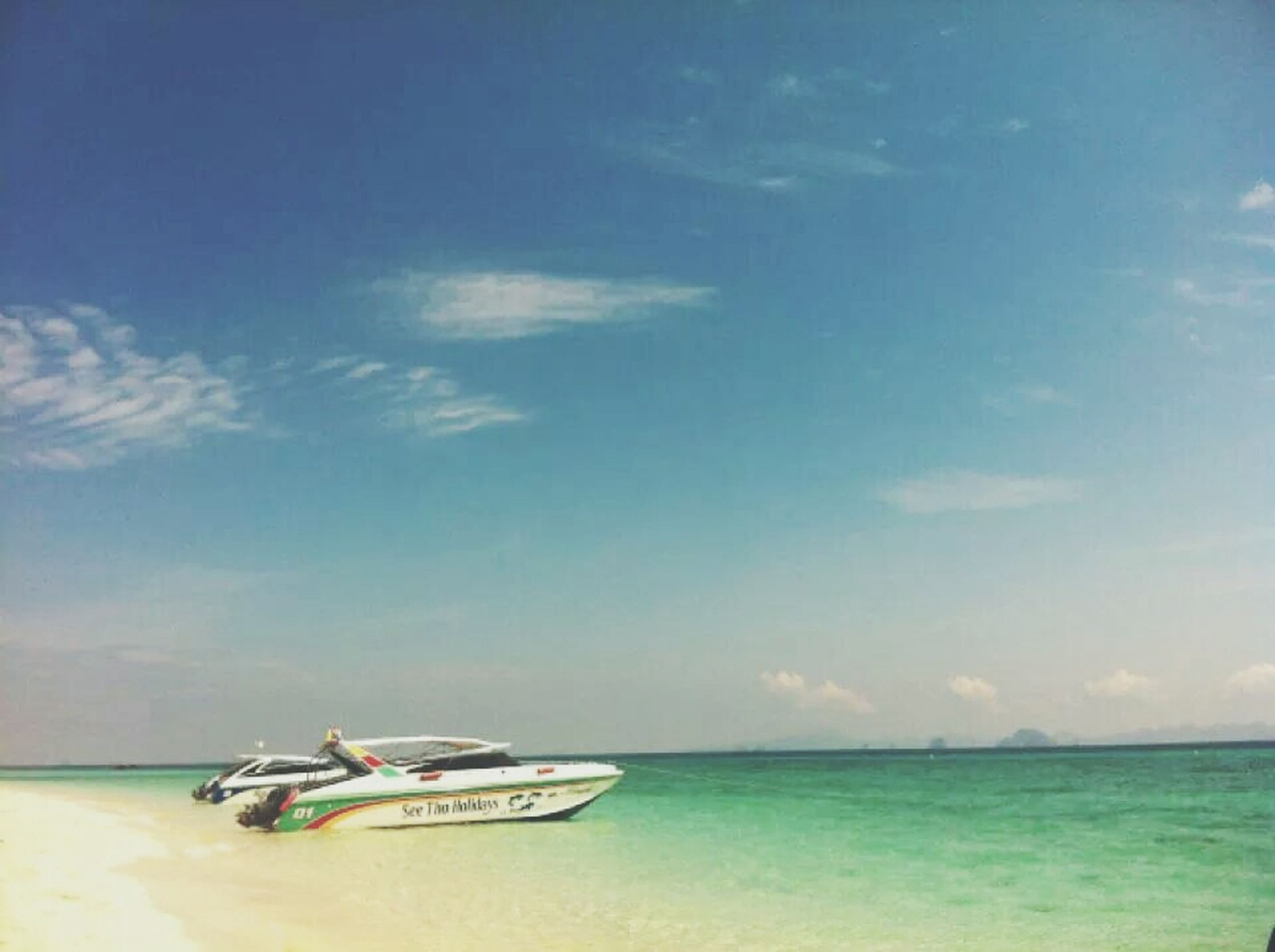 sea, water, transportation, nautical vessel, horizon over water, mode of transport, boat, sky, tranquility, blue, tranquil scene, beach, beauty in nature, nature, scenics, shore, day, outdoors, idyllic, waterfront