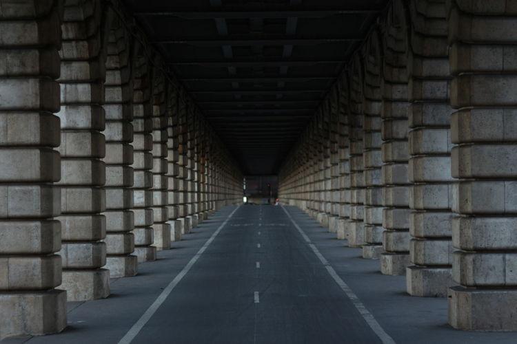 Road amidst columns