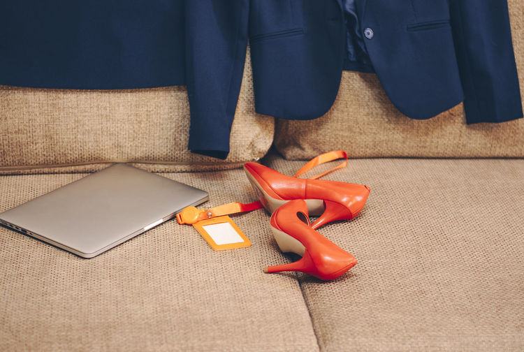 clothes and shoes with laptop business woman on the couch at home Technology Connection Midsection Still Life Red Business Indoors  Heels Women Accessories Business Business Finance And Industry Clothes Females Female Laptop Couch international women's day 2019