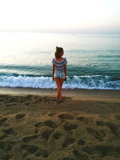Beach One Person Horizon Over Water Water Rear View Standing Sand Sea Summer Wave Sky Photography Outdoors Beauty Girl One Woman Only Blondehairdontcare Alone Sunrise - Dawn Beach Photography