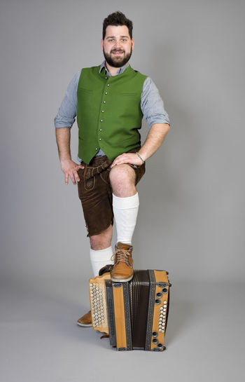 Musician Costume Leather Trousers Tradition Traditional Austria Green Pose Accordion Man Young Shorts Friendly Proud Happy Play Music Fun Joy Single One Background Copy Space Studio Entertainment Mountains Shirt STAND Hobby Leisure Cool Studio Shot Indoors  One Person Portrait Young Men Front View Gray Background Young Adult Standing Full Length Looking At Camera Casual Clothing Gray Beard White Background Mid Adult Men Smiling Cut Out