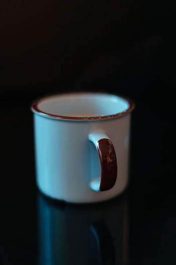 Cup Drink Food And Drink Mug Refreshment Focus On Foreground Close-up Tea Cup Indoors  Black Background No People Studio Shot Single Object Copy Space Still Life Dark Reflection Table Candle Container Blue Crockery Electric Lamp