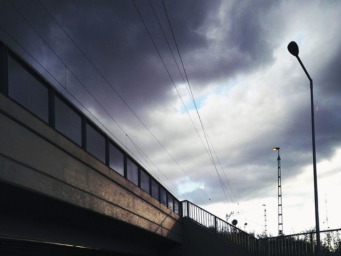 Cloud - Sky Sky Outdoors No People Low Angle View Rainy Day Afterrain GrungeStyle Lights Built Structure Architecture Rural Streetphotography Railway Bridge Perspective Moody Sky Moody Weather Moody The Street Photographer - 2018 EyeEm Awards