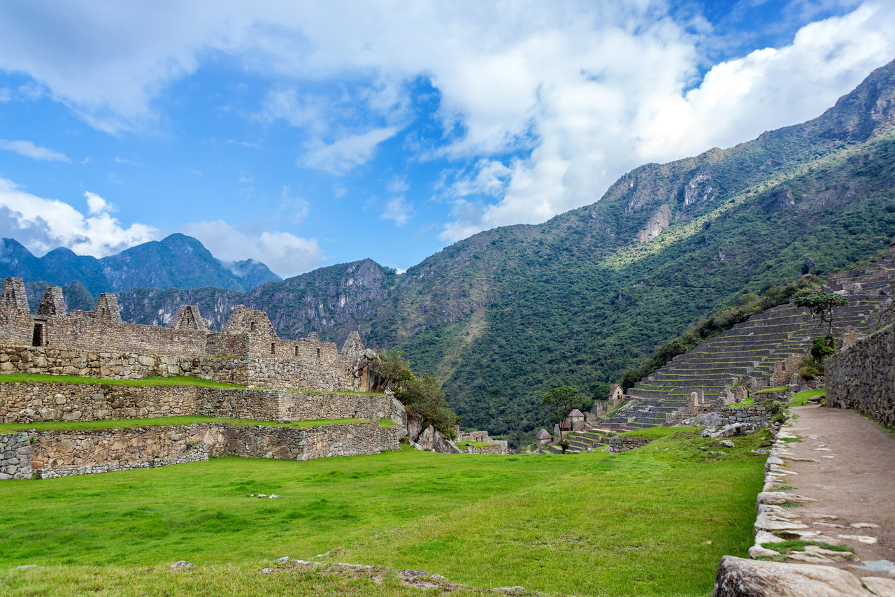 Old Ruins At Machu Picchu By Mountains Against Sky