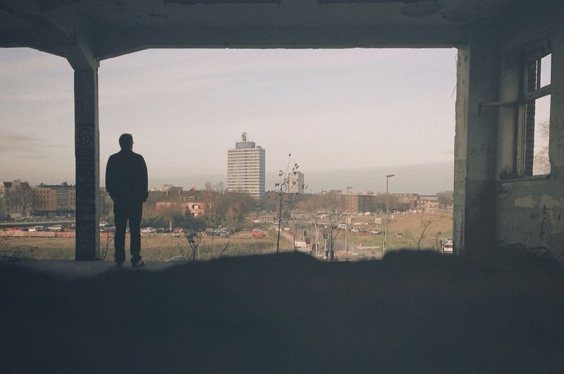 Full length of woman looking at cityscape