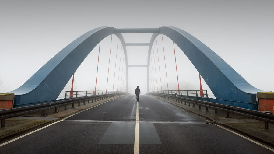 Strodehne Architecture Bridge Bridge - Man Made Structure Built Structure Connection Day Fog Havelland Men One Person Outdoors People Real People Rear View Road Road Marking Selfie Sky Suspension Bridge The Way Forward Transportation Travel Destinations Walking