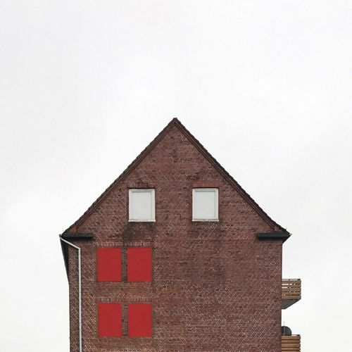 House Windows Balkony Brick Wall Tristesse Building Exterior Architecture Built Structure No People Clear Sky Red Day Outdoors