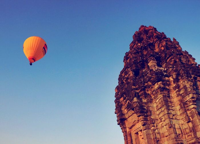 Hot air ballooning over Bakong Temple which was dedicated to Shiva and for a few years was the state temple of Angkor. Cambodia Bakong Temple Hotairballoon Hotairballoons Blue Temple Eye4photography  EyeEm Gallery Fresh 3 Check This Out Hello World Taking Photos Travel Photography Traveling