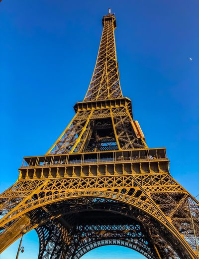 Moon Low Angle View Architecture Sky Tower Built Structure Travel Destinations Tall - High No People History The Past Travel Nature Clear Sky Blue Tourism City Building Exterior Metal Day Outdoors