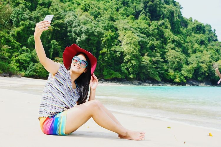 Beach Hat Photography Themes Wireless Technology Selfie Water Sand Mobile Phone Photographing Outdoors Lifestyles