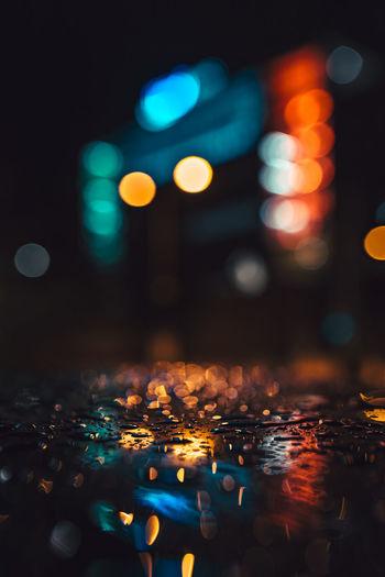Close-up of illuminated lights in city at night
