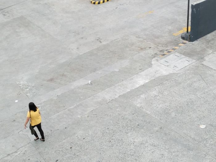 High angle view of man standing on street
