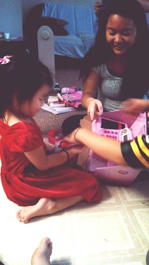 Lily playing with her toy cash register she got <3