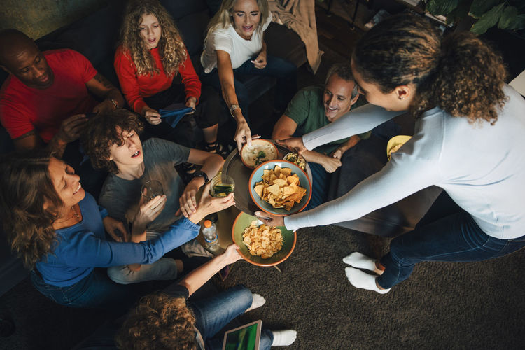 High angle view of people sitting by food