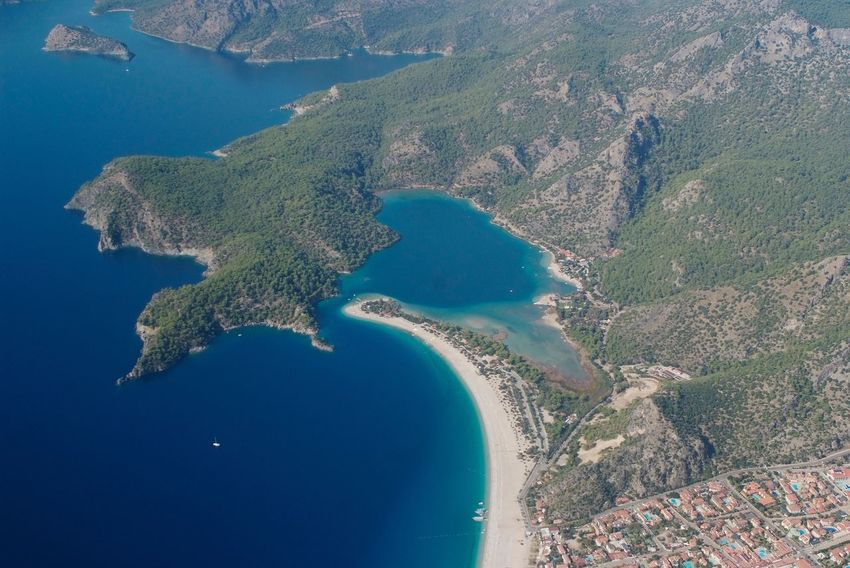 Paragliding down to the blue lagoon Water Aerial View Mountain Blue Nature Scenics Sea Physical Geography Day Landscape Outdoors No People Beauty In Nature Sky Paragliding Blue Lagoon Ölüdeniz, Fethiye Turkey Flying High