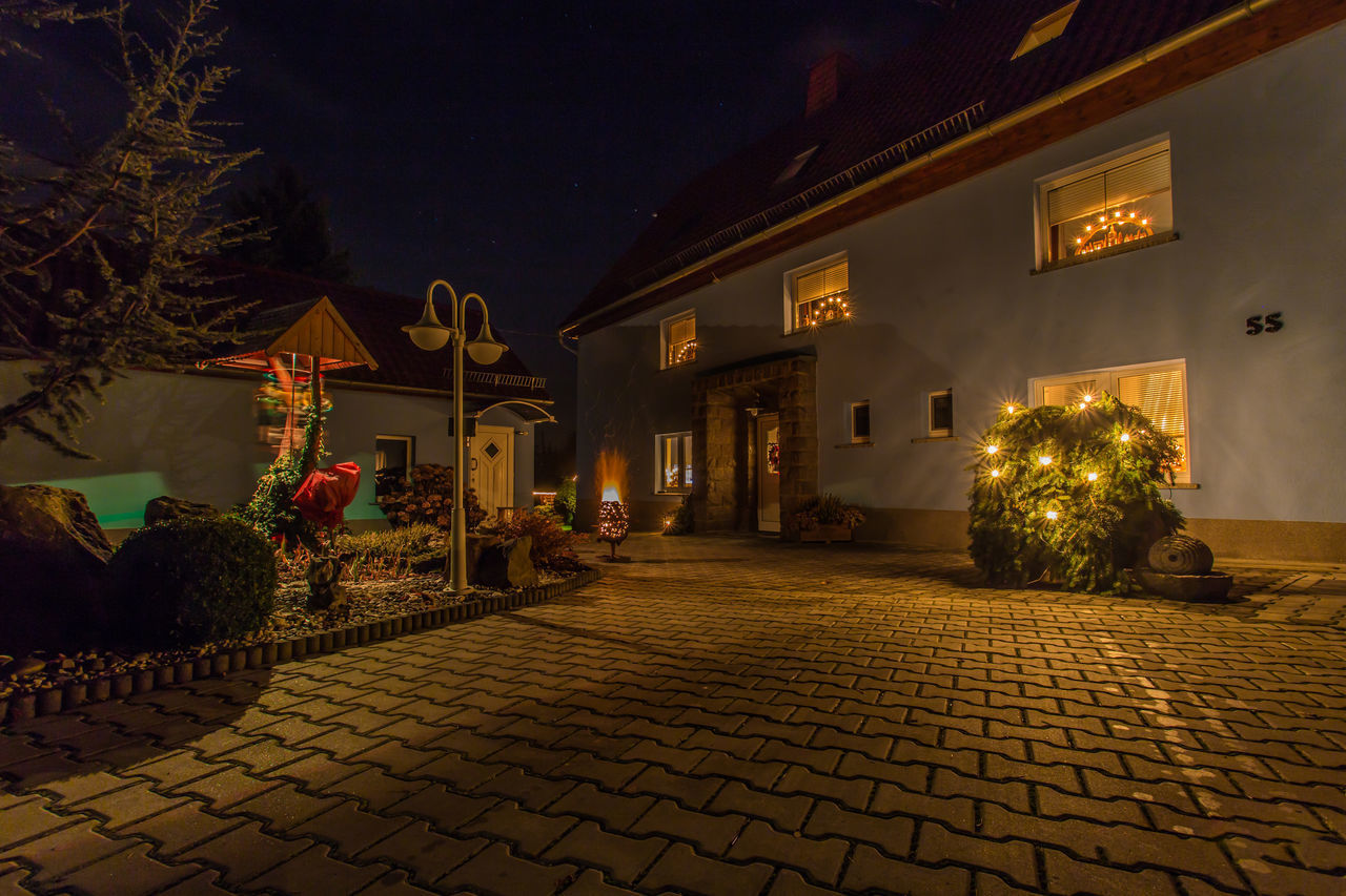 architecture, night, illuminated, built structure, building exterior, building, cobblestone, house, street, tree, city, nature, plant, outdoors, no people, lighting equipment, christmas, residential district, decoration, footpath