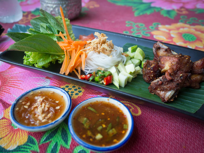 Pork rib thai food on Chatuchak Market, Bangkok Bangkok Chatuchak Chatuchak Weekend Market Market Salad Thailand Bowl Close-up Colorful Day Food Food And Drink Freshness Healthy Eating Indoors  Meat No People Plate Ready-to-eat Ribs Serving Size Street Food Table Thai Food