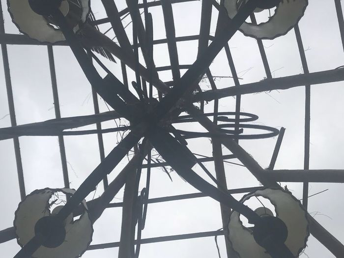 Changing the roof, only the lamps remain Low Angle View Sky Built Structure Day Architecture No People Nature Metal Outdoors Silhouette Pattern Cloud - Sky Connection Geometric Shape Close-up Grid Sunlight Construction Site Directly Below