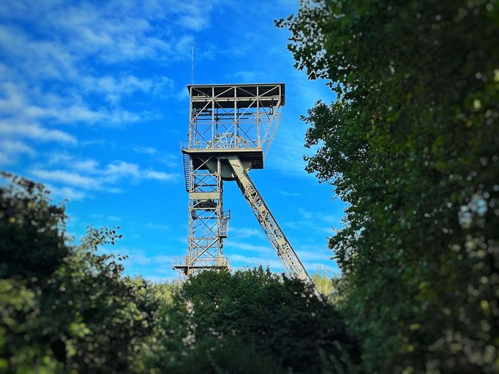 Low angle view of old tower against blue sky