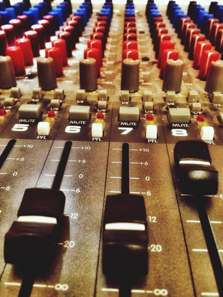 A sound mixing desk. Sound Desk Mixing Desk Levels Dial Dials Slider Sliders Knob Knobs Button Buttons Switch Switches Sound Noise