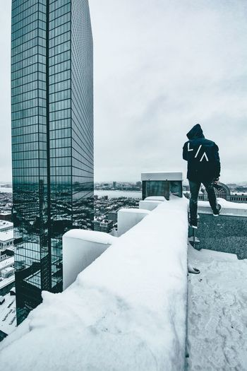 Man standing on snow covered city in winter