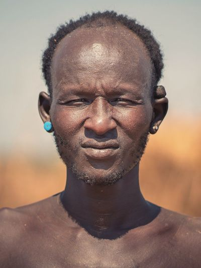 Dassanech Tribe Man near Omorate / Ethiopia Dassanech Tribe Africa African Ethiopian Portraits Omo Valley Ethiopian Photography 🇪🇹 Ethiopia Portrait Photography Tribal Tribes Headshot Portrait One Person Front View Close-up Looking At Camera Human Face Body Part Lifestyles Real People Human Body Part Leisure Activity Adult Young Adult Nature Young Men Shirtless Outdoors Contemplation
