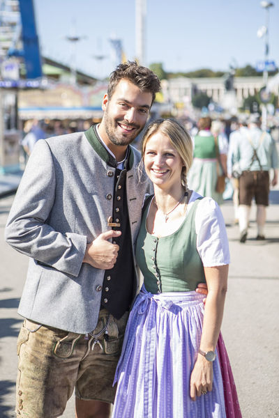 A young German couple pose in front of the camera at the Octoberfest festival in Munich, Germany Bavarian Girl Bavarian Man Bavarian Style Couple Couple - Relationship Dirndl Festival Freedom German Style Germany Happiness In Love Lederhosen Munich München Octoberfest Party Relationship Style Theresienwiese Togetherness Tracht Two People Wiesn Young