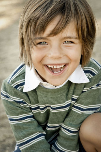 Boy laughing Childhood Child Portrait Smiling Looking At Camera Happiness Emotion One Person Casual Clothing Front View Teeth Toothy Smile Headshot Mouth Open Hairstyle Laughing Out Loud Looking Down From Above Shirt Stripes Pattern Cute