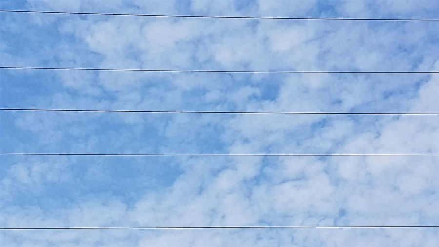 Sky staff Clouds And Sky Looking Up Parallel Blue Backgrounds Cable Technology Electricity  Copy Space Sky Close-up Power Line  Electric Pole Wire Power Cable