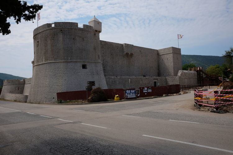 16th century Fort, Ston 16 Century Ancient Blue Sky White Clouds Castle Croatia Fort Architecture Past Architecture Bastion Building Building Exterior Castle Architecture Castle Wall Castle Walls Flag Fort Fort Wall Fort Walls Fortress Wall History No People Outdoor Photography Road Symbol Turret