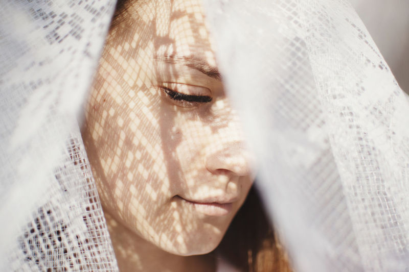 Close-up of woman wearing veil