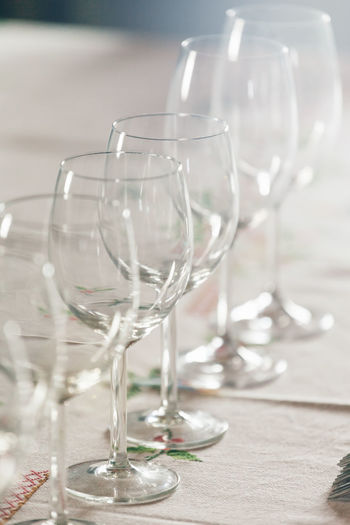 Row of empty wineglasses on table