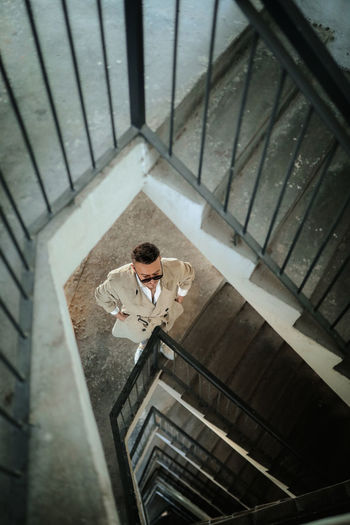 High angle view of man standing on staircase