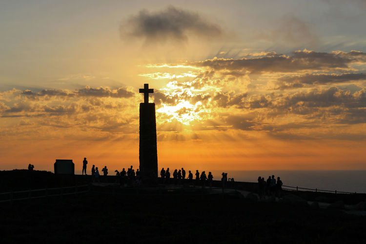 Repost Sunset 2015 . Eye4photography  EyeEm Best Shots EyeEm EyeEm Nature Lover EyeEmBestPics Golden Hour Sky And Clouds Sunset Silhouettes Sunset_collection Sunsetporn Naturelovers People People Watching People Photography Seaside Colors Cross Sunset And Clouds  EyeEm Gallery Taking Photos at Cabo Da Roca Portugal