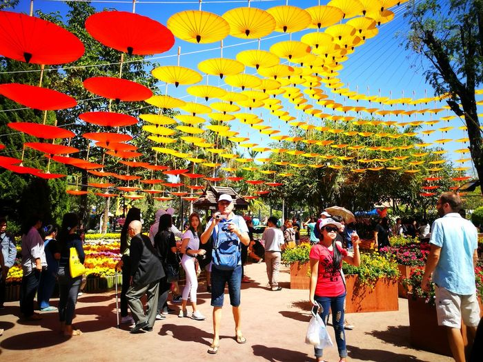 Mobile Conversations People Chiang Mai   Thailand Multi Colored Large Group Of People Men Tree Women Celebration Real People Adults Only Adult Architecture Outdoors Sky Only Men Day