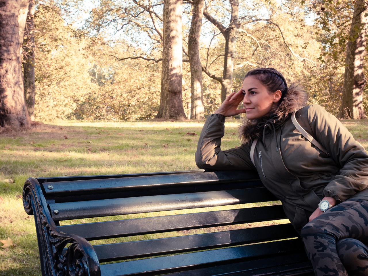 Young Woman Relaxing On Bench In Park