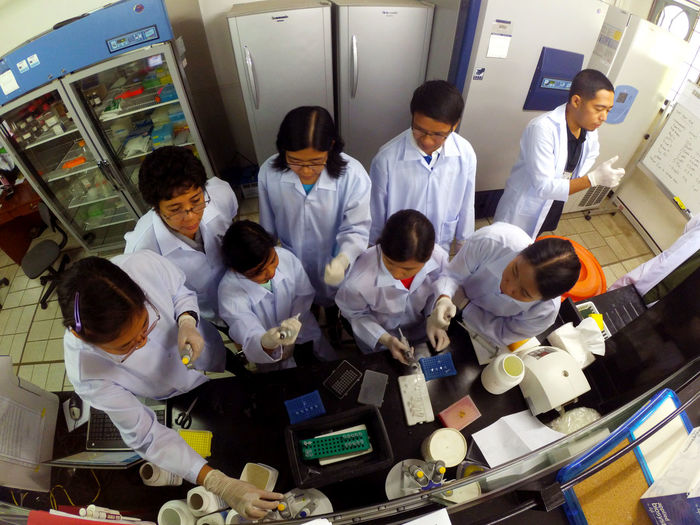 Science Cooperation Coworker Group Of People Laboratory Experiments Laboratory Training Molecular Laboratory Molecular Laboratory Experiment Occupation Real People Researchers Scientists Standing Togetherness Uniform