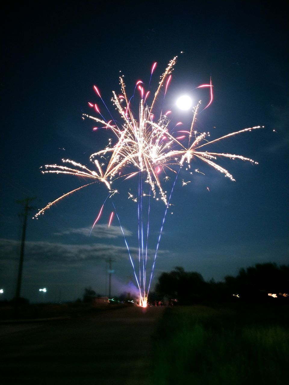 night, firework display, celebration, arts culture and entertainment, illuminated, firework - man made object, event, long exposure, exploding, sky, glowing, low angle view, outdoors, firework, no people, motion, blurred motion, multi colored