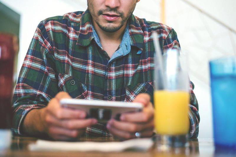 Human Meets Technology Phone Face Man Breakfast Food Morning Restaurant Eating Technology Culture Society Mygeneration Flannel Patterns Public Shallow DOF Blurred Relaxing