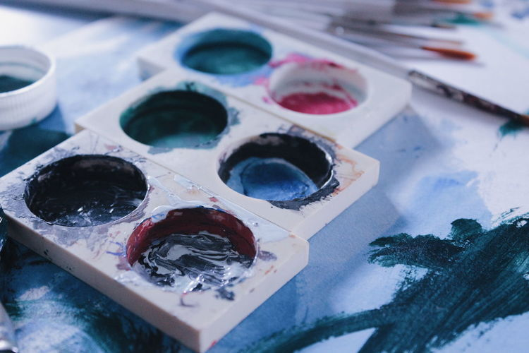 Close-up of messy palette on table