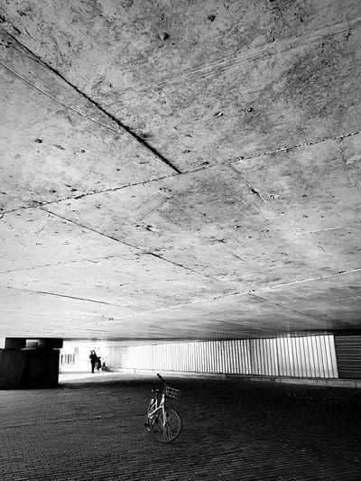 Bicycle parked below building