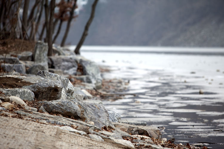 Cold Cold Temperature Day Frozen Geology Horizon Over Water Ice Nami Island Nature Outdoors Physical Geography Power In Nature Riverside Rock Rock - Object Rock Formation Rough Scenics Sea Stone Textured  Tranquility Water Wave Winter
