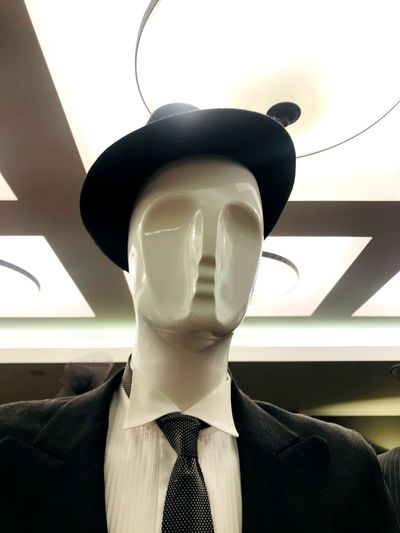 Male mannequin head in hat Mannequin Human Representation Clothing Representation Indoors  Female Likeness Store Window Fashion Retail  Men Business Retail Display Shopping Human Body Part Male Likeness Clothing Store Menswear Store Window Consumerism